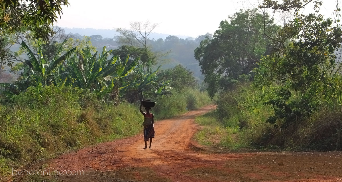 Woman walking in Togo with basket on her head